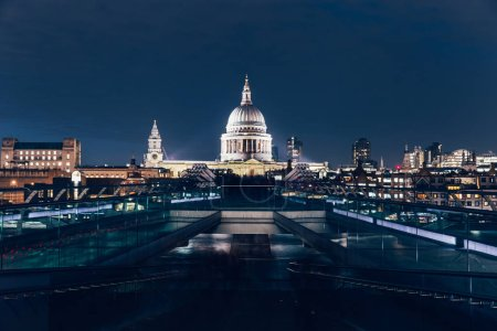 St Pauls Cathedral Millennium Bridge on London city skyline at night