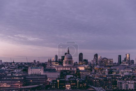 Aerial view of modern London city skyline at sunset with sky and clouds