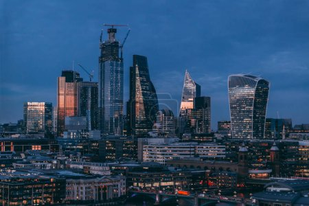City of London modern skyline business financial distict at night lights
