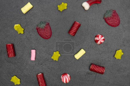 Photo for Candy sweets abstract minimal food dark background top view - Royalty Free Image