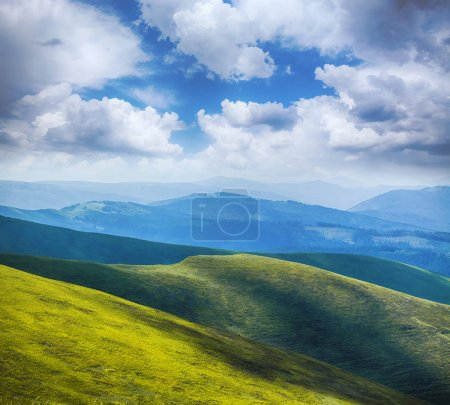 Photo for Green mountain meadow with mountain range in the background.at Carpathian mountains - Royalty Free Image