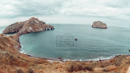 Photo for Gaztelugatxe island on Vizcaya, Spain. It has a small hermit on top - Royalty Free Image