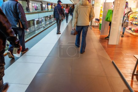 Shoppers at multilevel shopping center. Mall Interior.