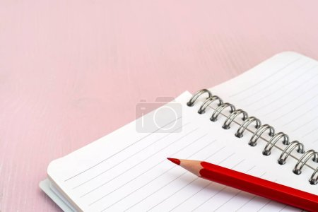 Photo for Red pencil and notebook for notes. - Royalty Free Image