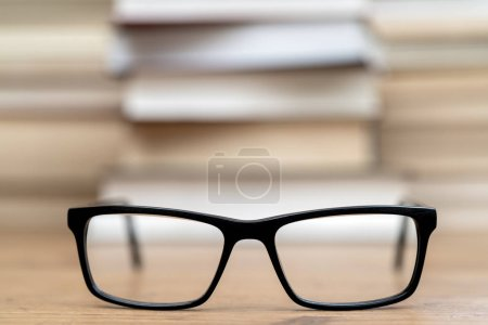 Photo for Glasses on the background of books. Symbol of knowledge, science, study, wisdom. - Royalty Free Image