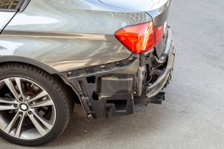 Tail of modern car with removed rear bumper. Vehicle after traffic accident and crash. Transport repair and insurance.