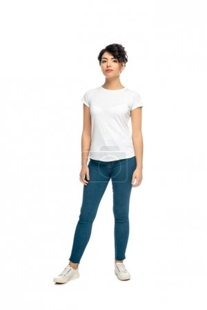 Photo for Attractive latin brunette woman standing in blue jeans and white t-shirt isolated on white - Royalty Free Image