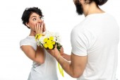 cropped view of bearded man giving flowers to surprised latin woman isolated on white