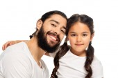 happy latin father smiling near cute daughter isolated on white