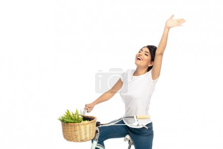 Photo for Happy latin woman with outstretched hand riding bicycle isolated on white - Royalty Free Image