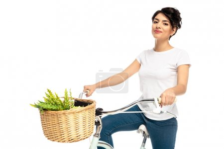 Photo for Latin happy woman riding bicycle and smiling isolated on white - Royalty Free Image