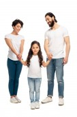 happy latin parents holding hands with cute daughter while standing isolated on white