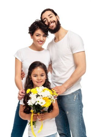 latin parents smiling near cute daughter holding flowers isolated on white