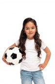 "Постер, картина, фотообои ""cheerful latin kid standing with hand in hip and holding soccer ball isolated on white """