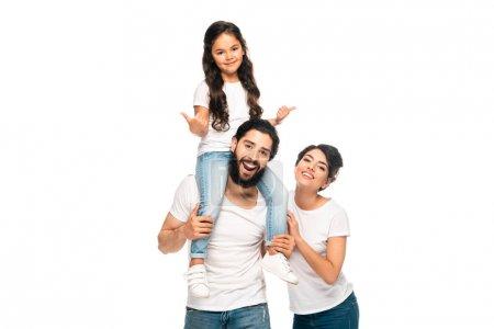 Photo pour Père latin heureux portant sur des épaules mignonne descendant affichant des pouces vers le haut près de la femme heureuse d'isolement sur le blanc - image libre de droit