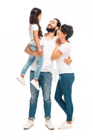 Photo for Happy latin man holding in arms cute daughter while standing with attractive wife isolated on white - Royalty Free Image