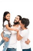 happy latin man holding in arms adorable daughter while smiling near wife isolated on white