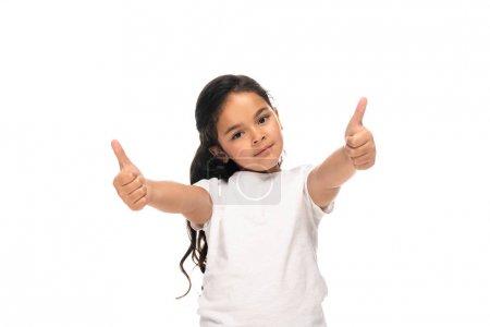 Photo pour Enfant latin heureux affichant des pouces vers le haut d'isolement sur le blanc - image libre de droit