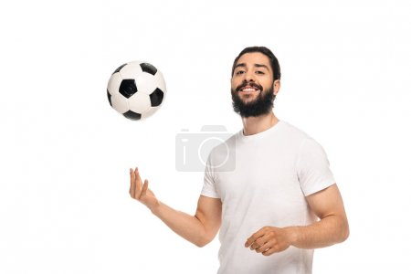 Photo for Happy latin man throwing in air soccer ball and smiling isolated on white - Royalty Free Image