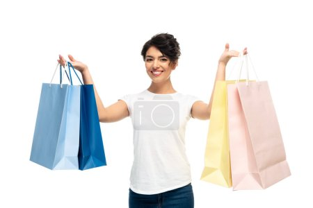 Photo for Happy latin woman holding shopping bags and smiling isolated on white - Royalty Free Image
