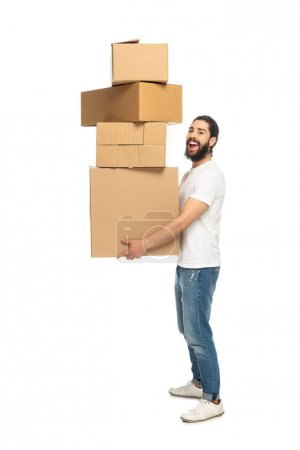Photo for Cheerful latin man holding carton boxes and smiling isolated on white - Royalty Free Image