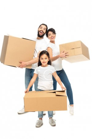 Photo for Happy latin parents holding boxes and smiling near cute daughter isolated on white - Royalty Free Image