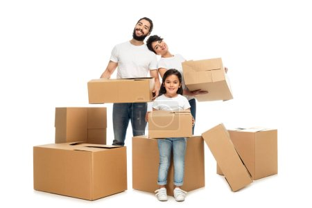 Photo for Cheerful latin parents holding boxes and standing near cute daughter isolated on white - Royalty Free Image