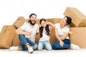happy latin man showing thumb up near kid gesturing and wife smiling near boxes isolated on white