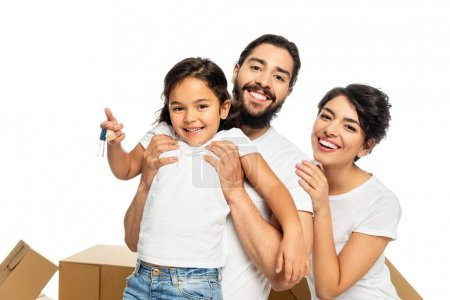 Photo for Happy latin father holding in arms cute kid holding keys and smiling isolated on white - Royalty Free Image