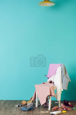 Photo for Messy room with trendy clothes and shoes on chair - Royalty Free Image
