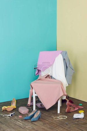 Photo for Messy room with elegant clothes and shoes on chair - Royalty Free Image
