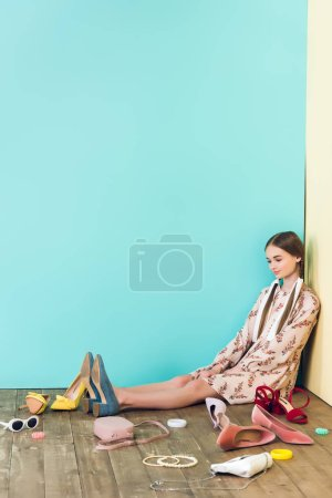 Photo for Stylish female teenager sitting on floor with mess - Royalty Free Image