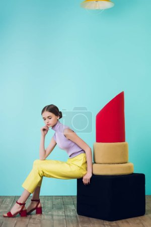 attractive fashionable girl posing with big red lipstick