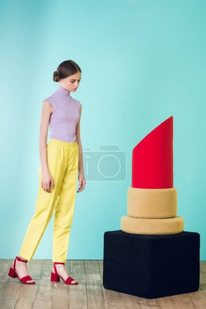 elegant stylish girl posing with big red lipstick