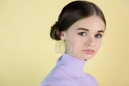 portrait of beautiful youth girl, isolated on yellow