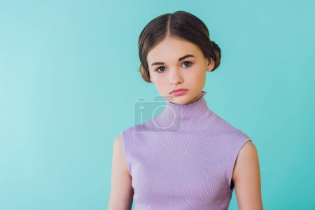 portrait of fashionable youth girl, isolated on turquoise
