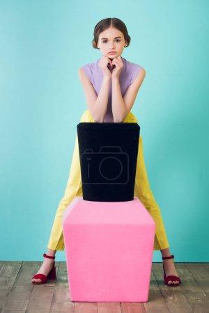 fashionable teen girl posing with big nail polish