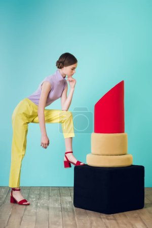 elegant teen girl posing with big red lipstick for fashion shoot
