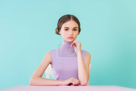 beautiful stylish teen girl sitting at table