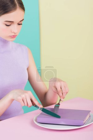 teen girl with book on plate, study concept
