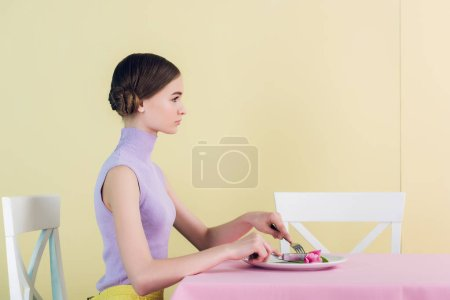 beautiful youth girl eating tulip flower, diet concept