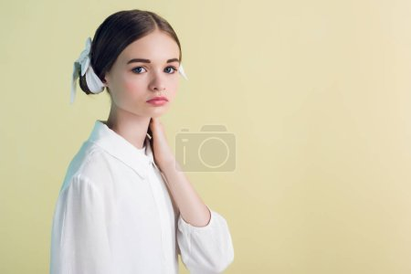 styling teen girl posing in white outfit, isolated on yellow
