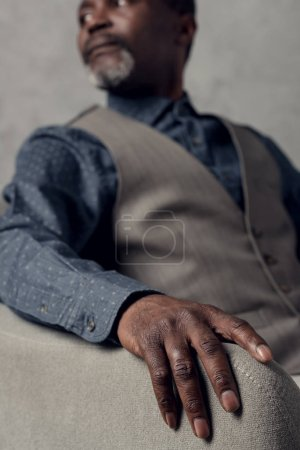 selective focus of hand of mature african american man