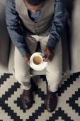 high angle view of stylish african american man with coffee cup