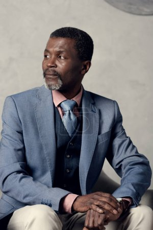 serious african american businessman in stylish suit