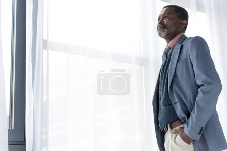 handsome mature african american man posing in blue jacket