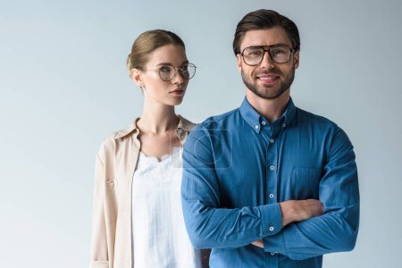 man and woman in stylish clothing and eyeglasses isolated on white