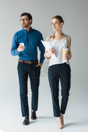 young business partners in stylish clothes on white