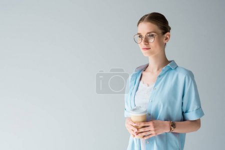 attractive young woman with paper cup of coffee isolated on grey
