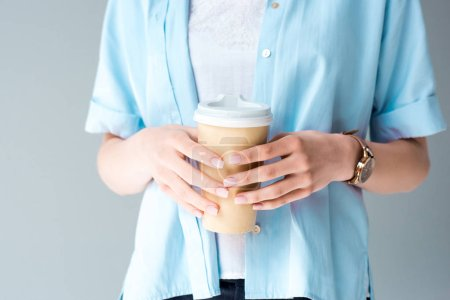cropped shot of woman with paper cup of coffee isolated on grey
